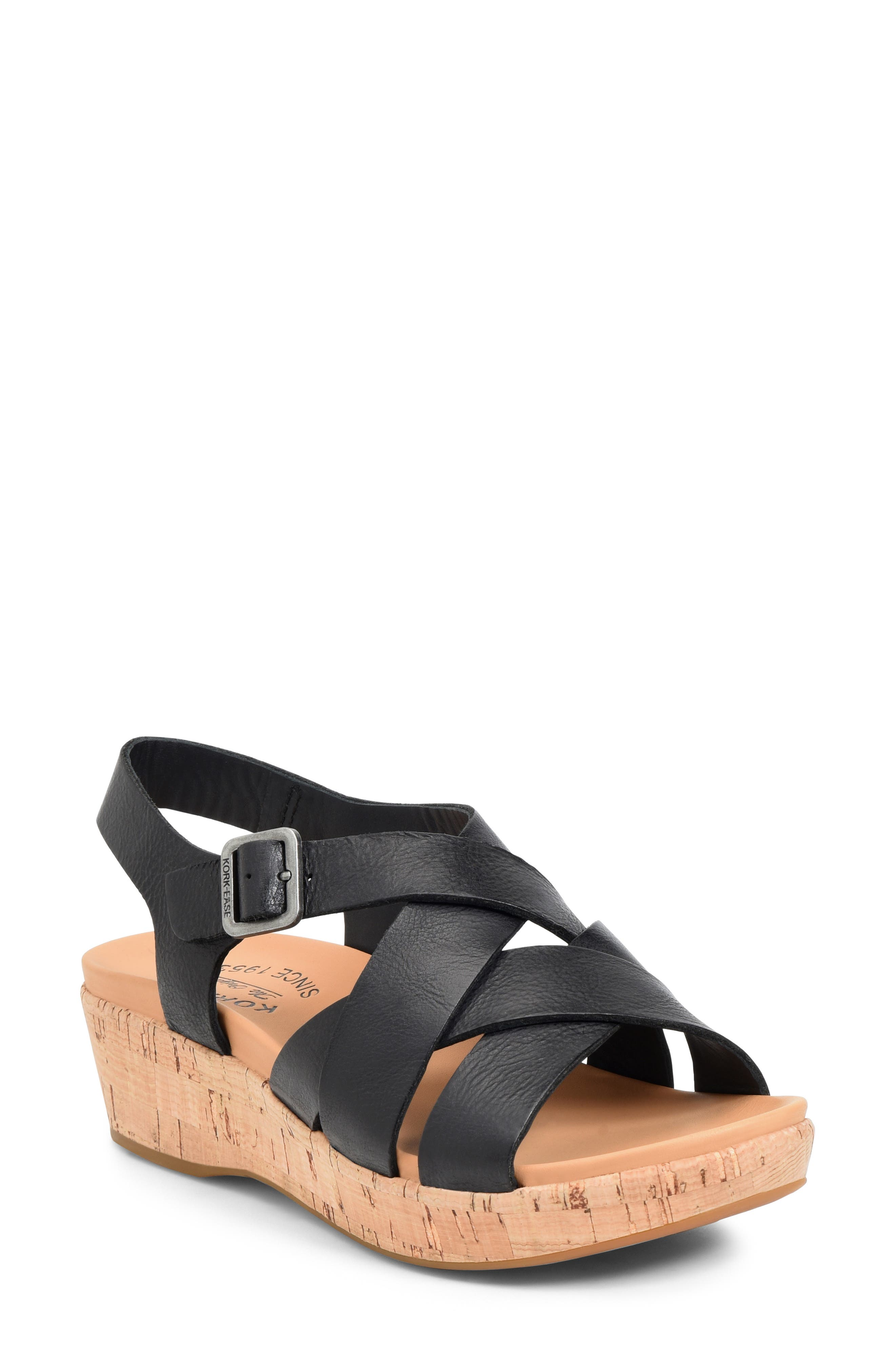 Interwoven straps and a cork-textured sole add contemporary-cool appeal to this well-cushioned sandal. Style Name: Kork-Ease Caroleigh Wedge Sandal (Women). Style Number: 6032798. Available in stores.