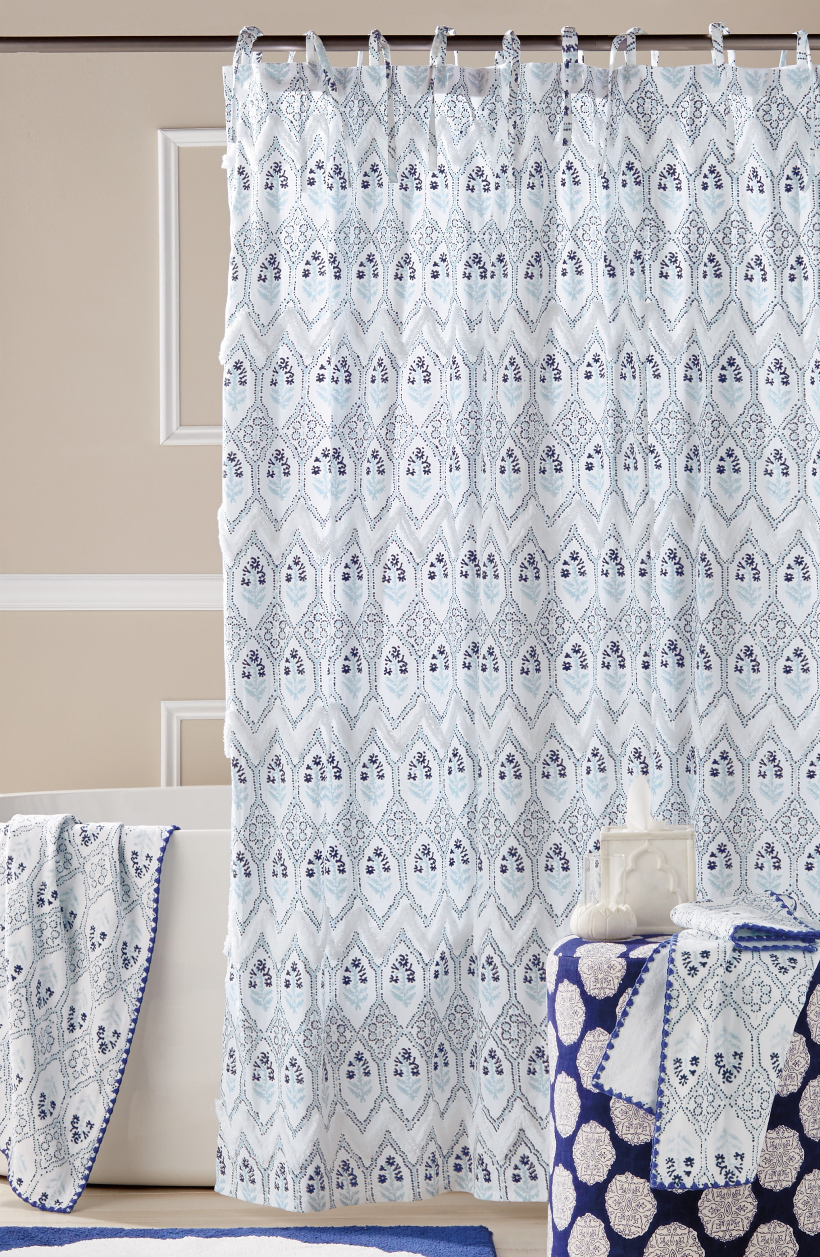 Cotton tufting adds dimensional texture to the block print of this shower curtain that hangs from either charming ribbon ties or more tailored buttonholes. Style Name: John Robshaw Sahasa Shower Curtain. Style Number: 6123475. Available in stores.