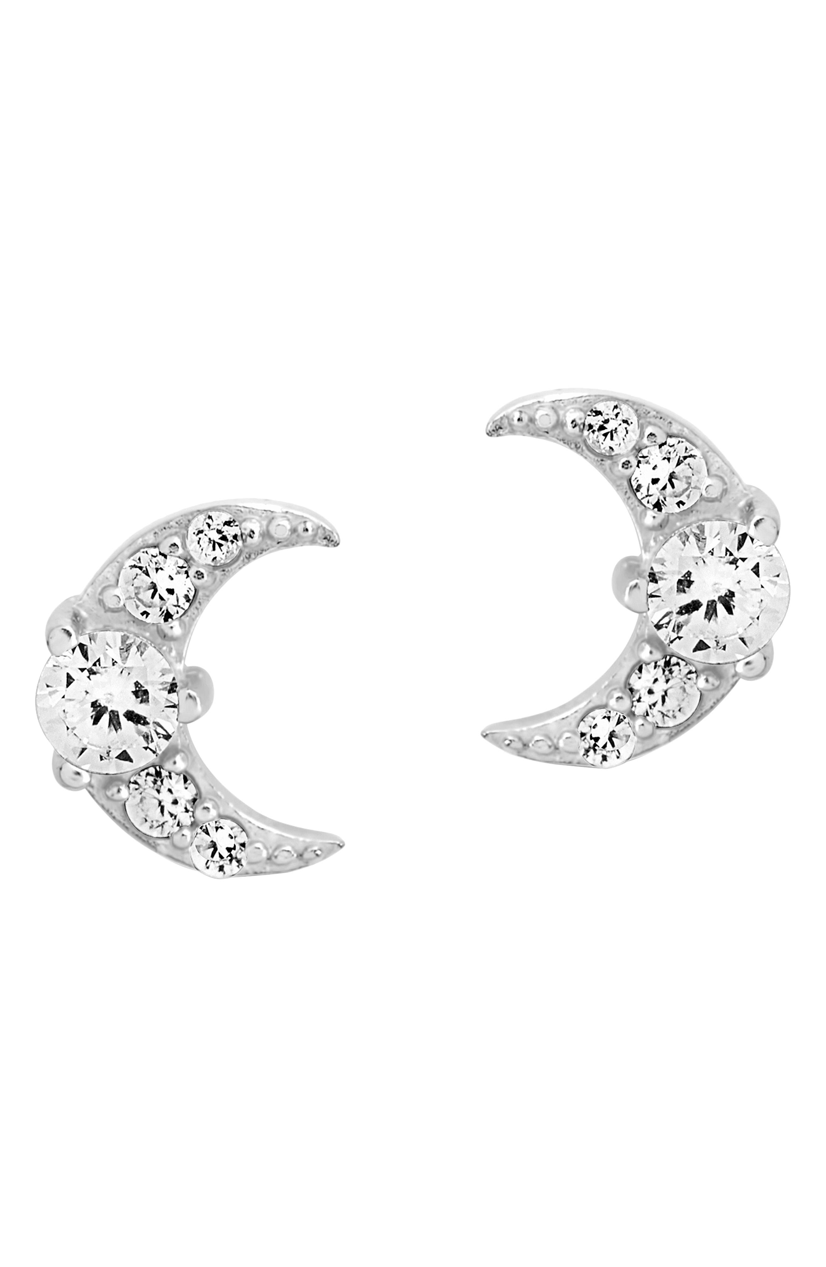 Gleaming crescent moons studded with sparkling cubic zirconia each form tiny but radiant stud earrings that bring a touch of celestial glamour to your lobes. Style Name: Sterling Forever Crescent Moon Stud Earrings. Style Number: 6114366. Available in stores.