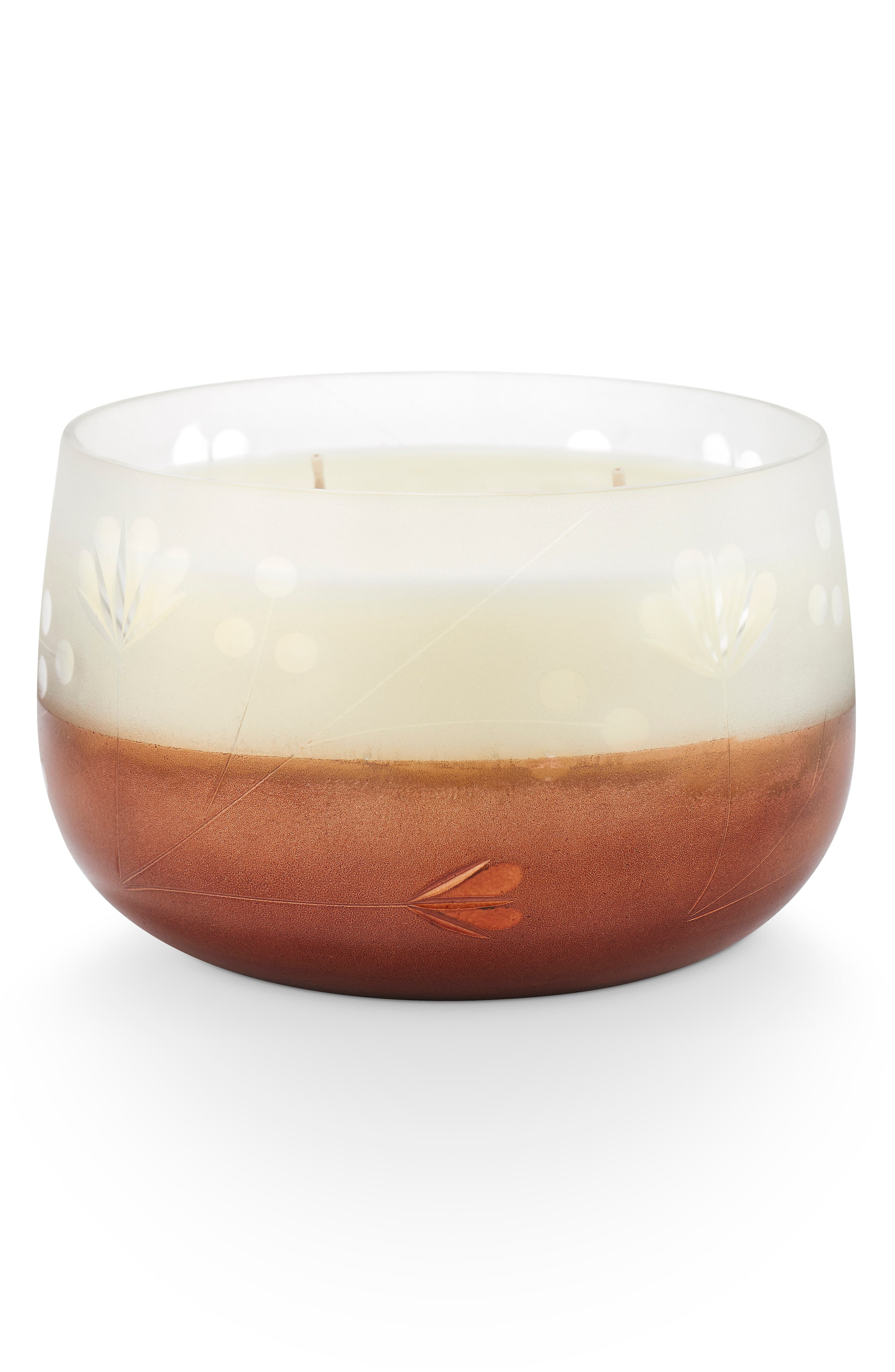 What it is: A fragrant candle housed in a leaved glass will bring a warm glow to any room. What it does: This candle features a wax base that\\\'s been pared down to a blend of only the best, 100% naturally derived waxes and oil for an even, clean burn. Fragrance story: Notes of roasted chestnuts, cinnamon and coconut create the quintessential fragrance of fall. Style: Warm, spicy. Notes:- Top: roasted chestnuts- Middle: cinnamon- Base: coconut.