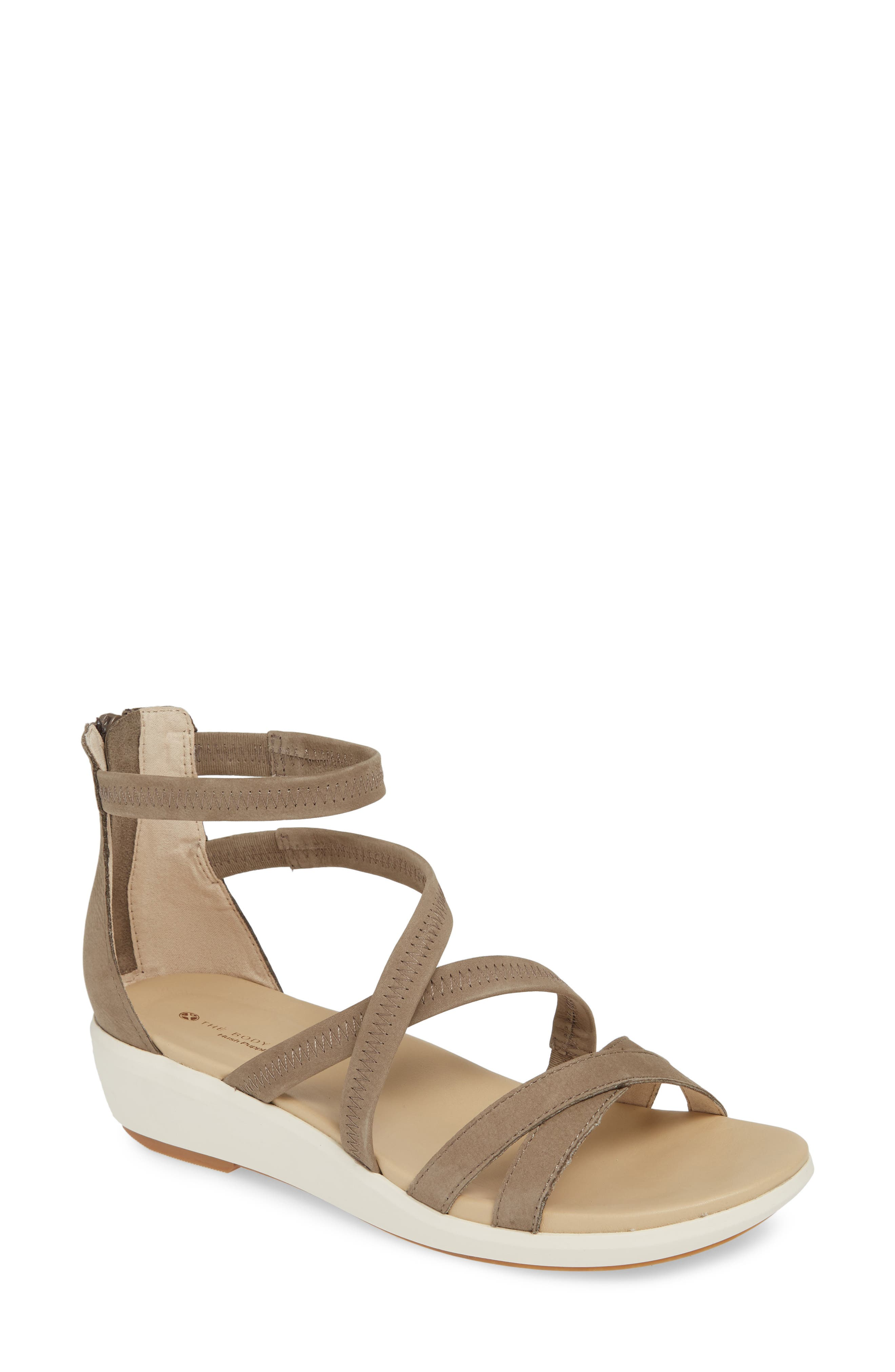 Slim crisscross straps style a breezy wedge sandal designed with an anatomically contoured footbed and BioBevel heel and toe for a natural, balanced stride. Style Name: Hush Puppies Lyricale Wedge Sandal (Women). Style Number: 5783916. Available in stores.