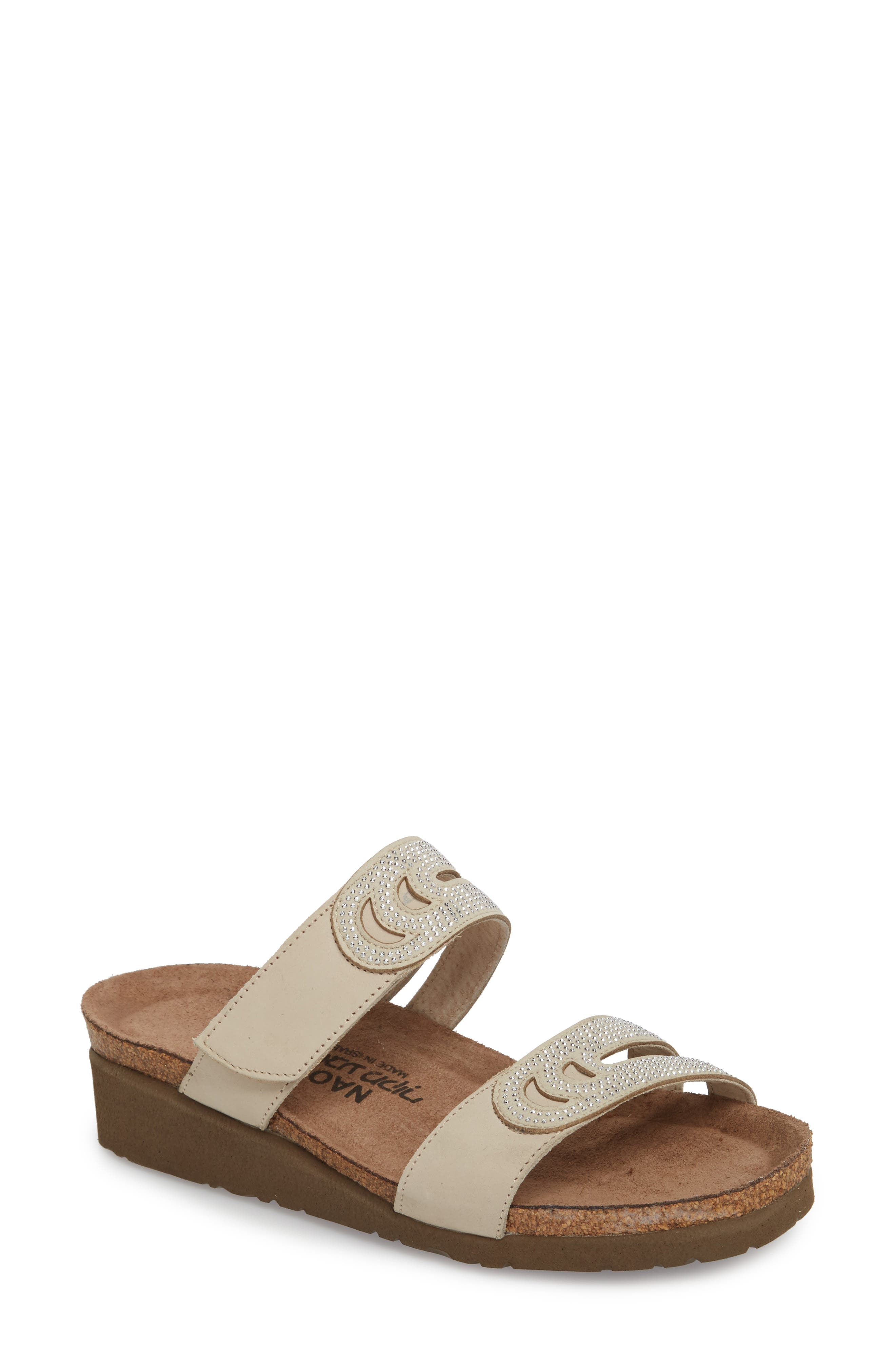 A layered-cork wedge and platform add a little lift to this comfy and completely adjustable slide sandal. The shock-absorbing, memory foam-cushioned footbed pampers your foot with every step you take. Style Name: Naot Ainsley Studded Slide Sandal (Women). Style Number: 5489715. Available in stores.