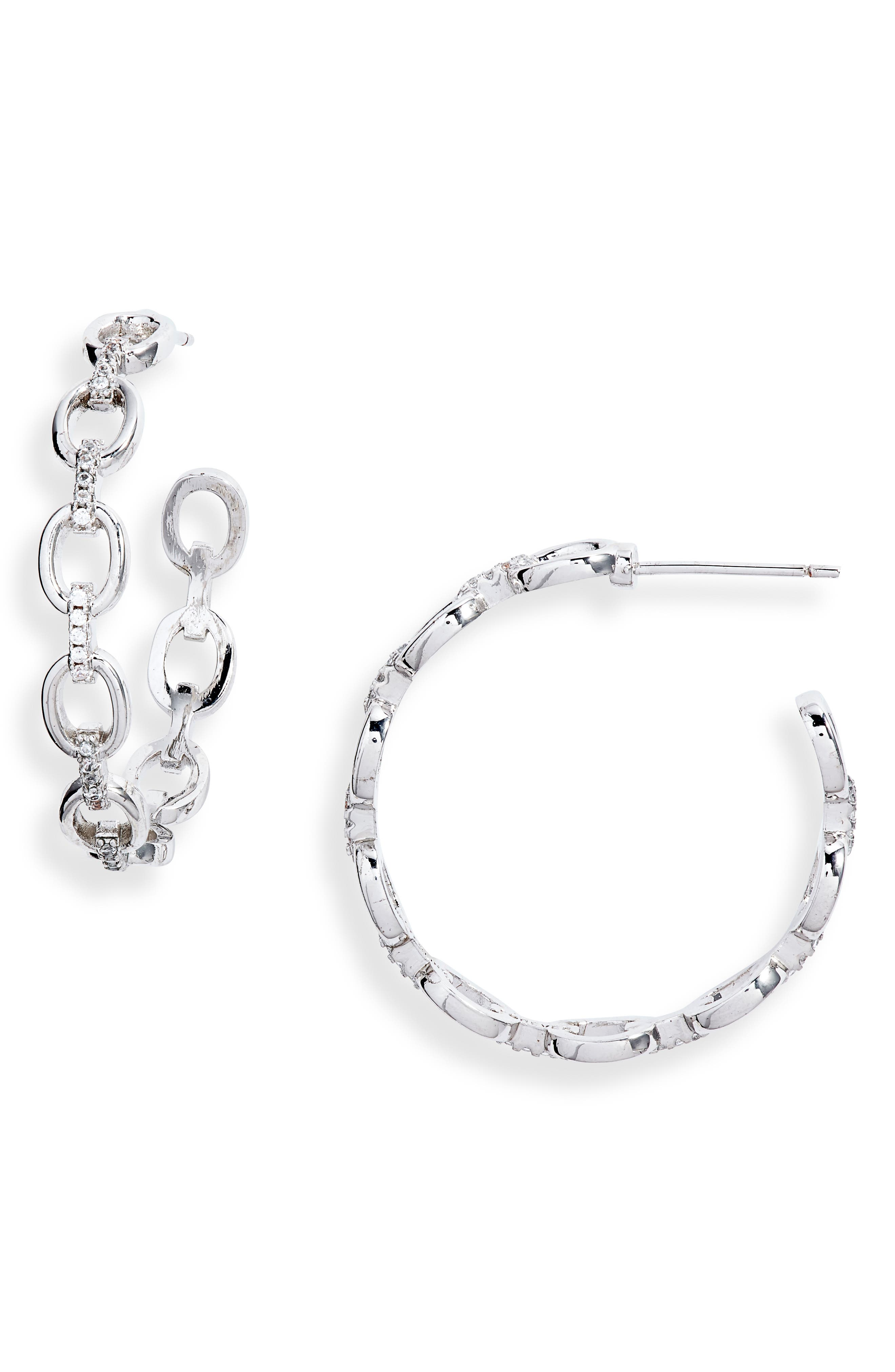 Sparkling cubic zirconia and chain-links update a pair of glamorous hoop earrings. Style Name: Sterling Forever Chain Hoop Earrings. Style Number: 5994880. Available in stores.