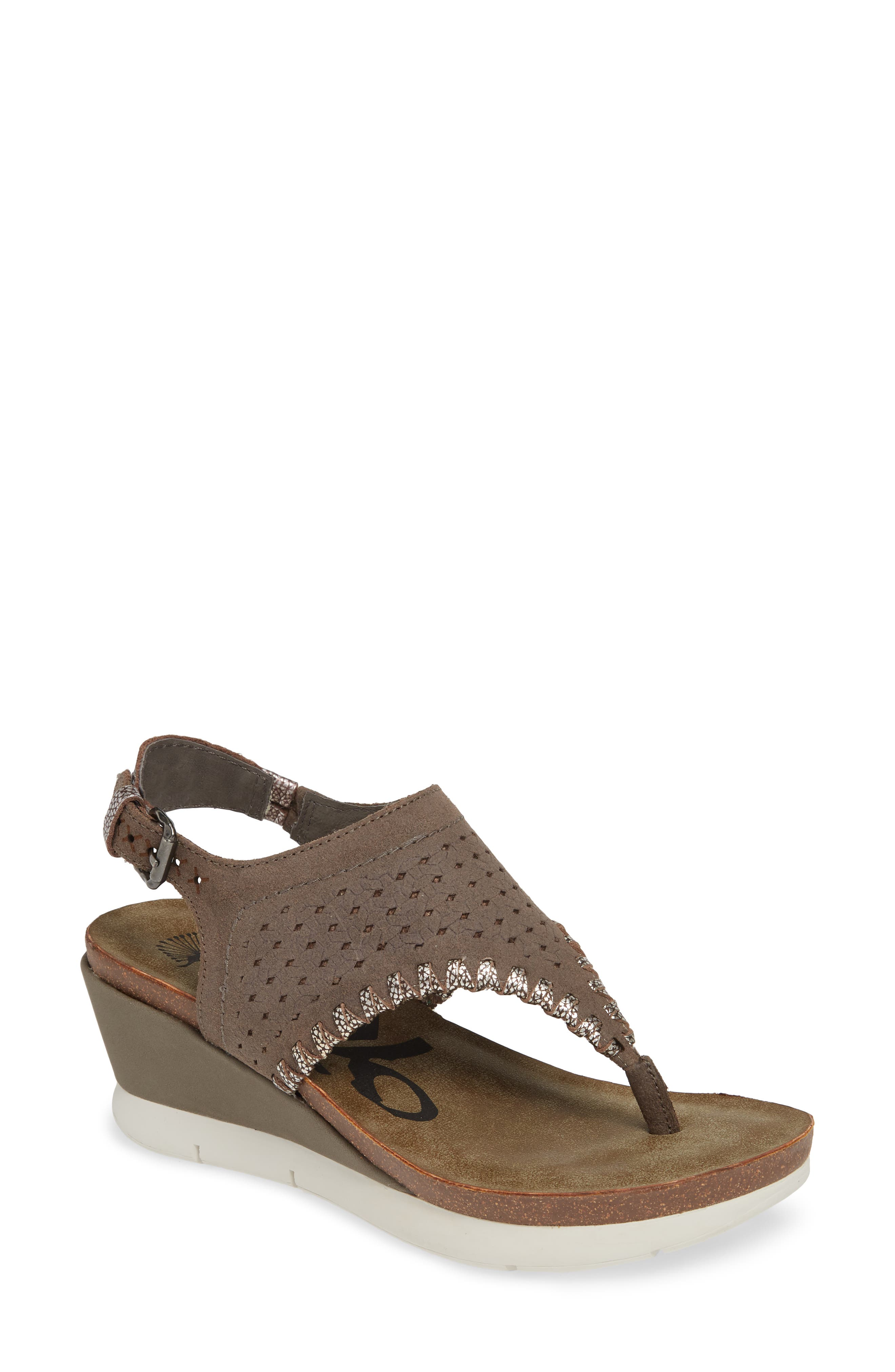 Tooled, whipstitch-outlined straps with an antiqued finish add to the old-world charm of a comfortable wedge sandal made with slip-resistant treads. Style Name: Otbt Meditate Wedge Sandal (Women). Style Number: 5517893 3. Available in stores.