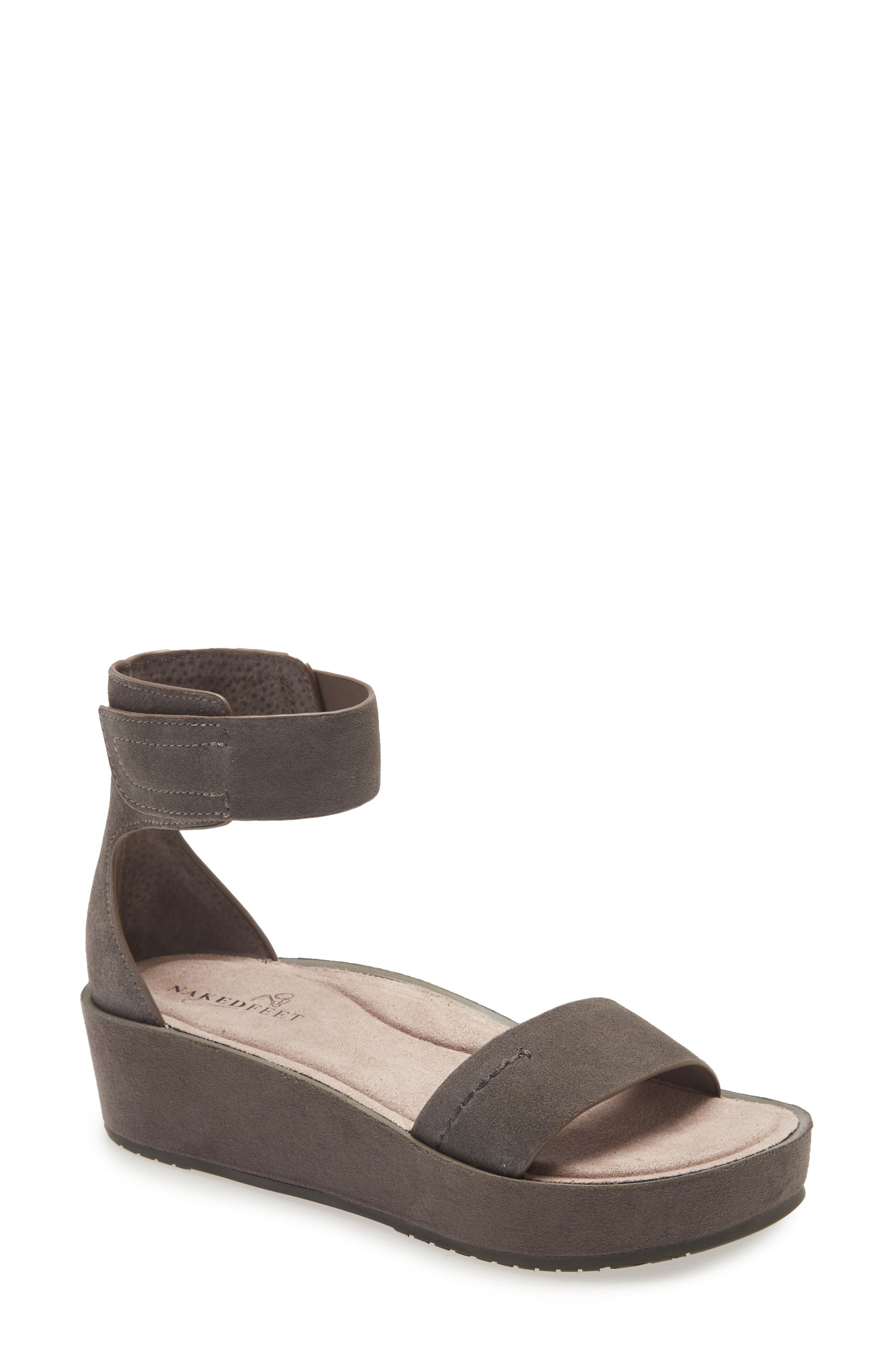 A pillowy footbed cushions every step in this modern ankle-strap sandal perched on a covered wedge and platform. Style Name: Naked Feet Renzi Platform Sandal (Women). Style Number: 6042923. Available in stores.