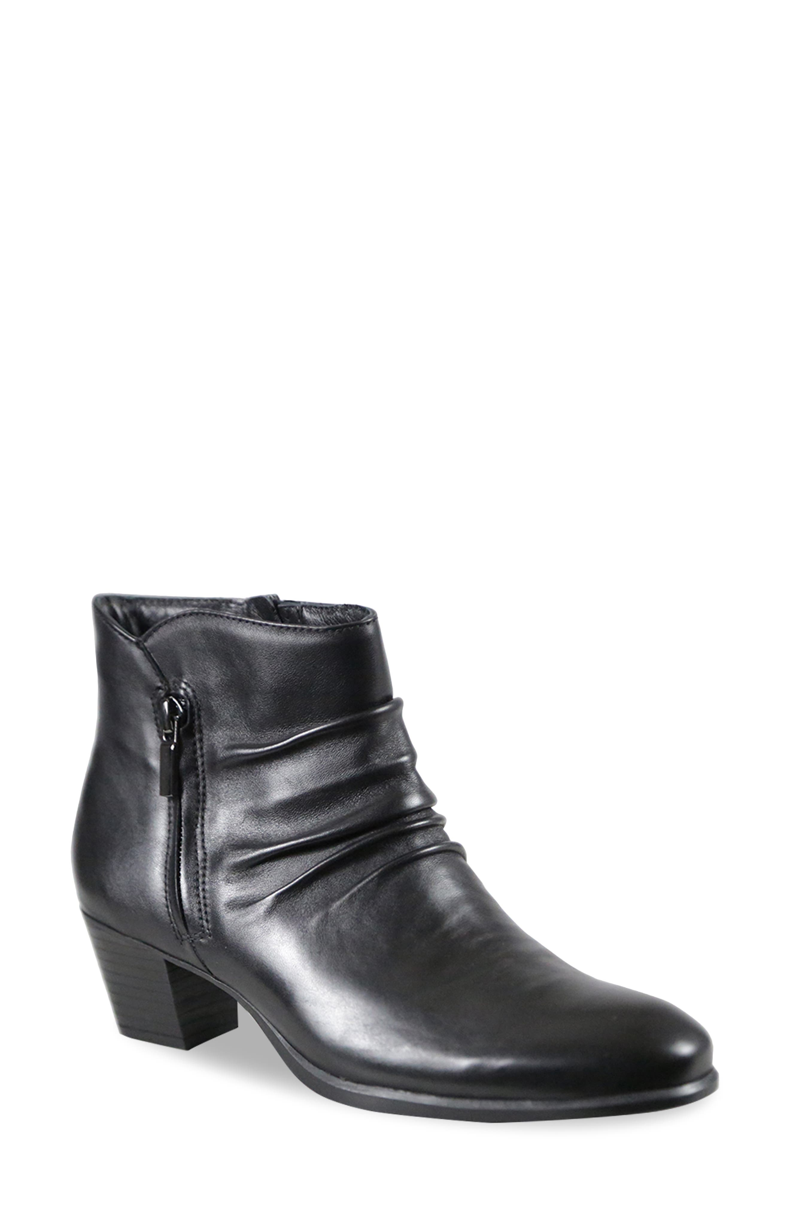 This comfort-centered bootie is styled with a slouchy silhouette and fitted with a cushy, arch-supporting footbed for support with every step. Style Name: Munro Elliot Bootie (Women). Style Number: 6066142. Available in stores.