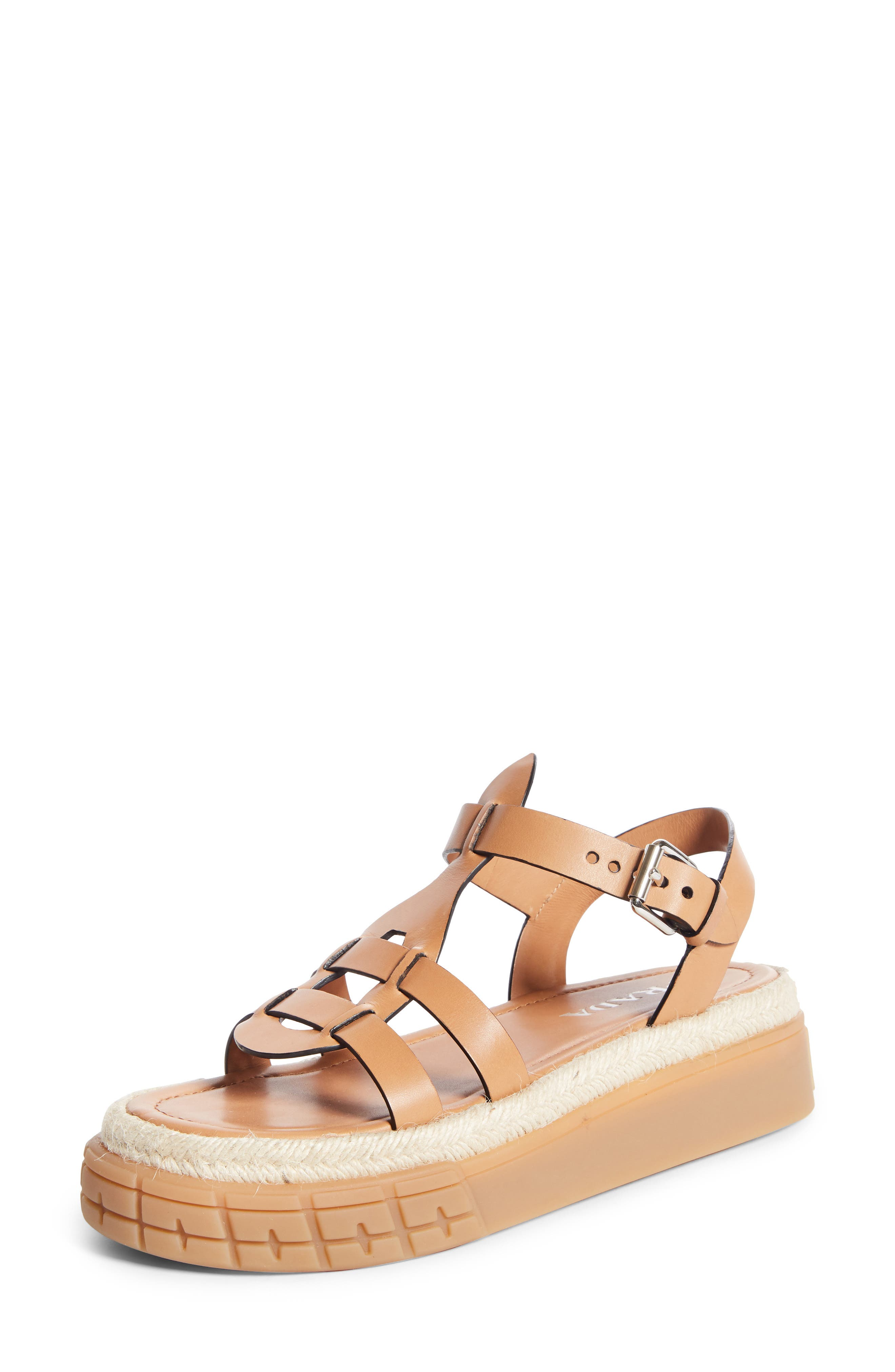 Pre-order this style today! Add to Shopping Bag to view approximate ship date. You\'ll be charged only when your item ships. Espadrille-inspired trim along the textured platform sole adds an earthy element to a casually sophisticated sandal topped with smooth leather straps. Style Name: Prada Platform Sandal (Women). Style Number: 5955899. Available in stores.
