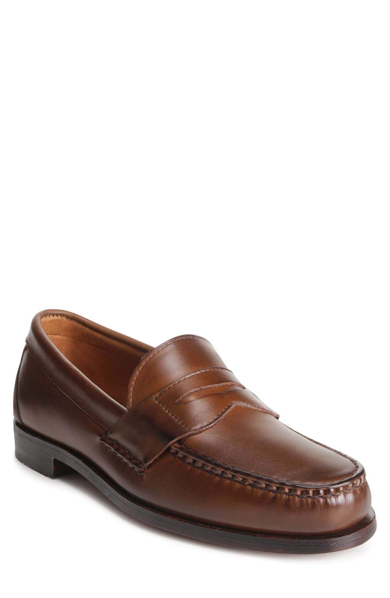 Smooth leather and a sharp penny strap define a hand-sewn loafer crafted with a semi-round moc toe and slightly shorter vamp for a fuller fit across the ball of the foot. Style Name: Allen Edmonds \\\'Cavanaugh\\\' Penny Loafer (Men). Style Number: 888867. Available in stores.