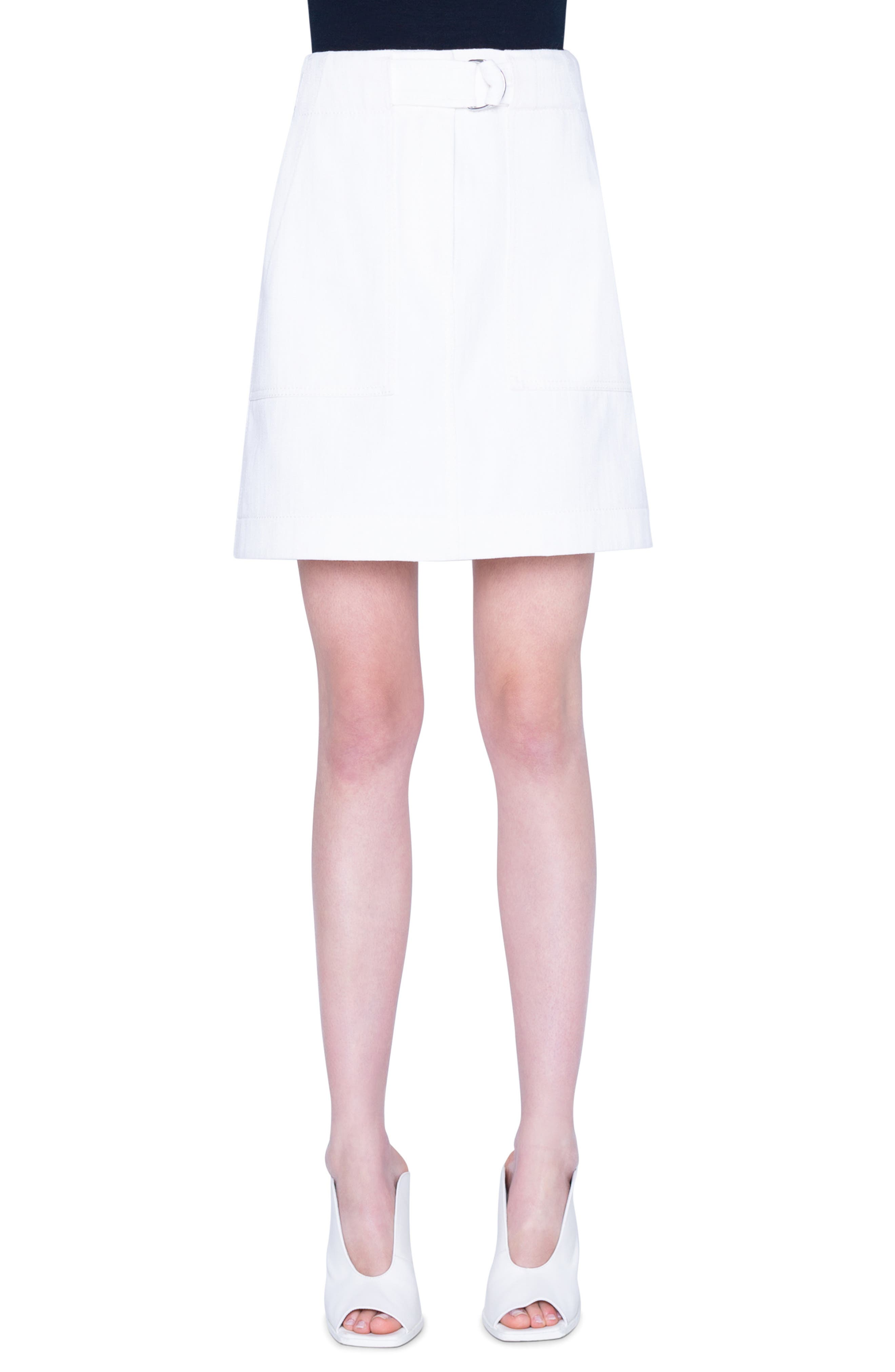 Cargo pockets and an attached D-ring belt lend utilitarian appeal to this A-line miniskirt made from cotton stretch gabardine. Style Name: Akris Punto Stretch Cotton Cargo Skirt. Style Number: 5917854. Available in stores.