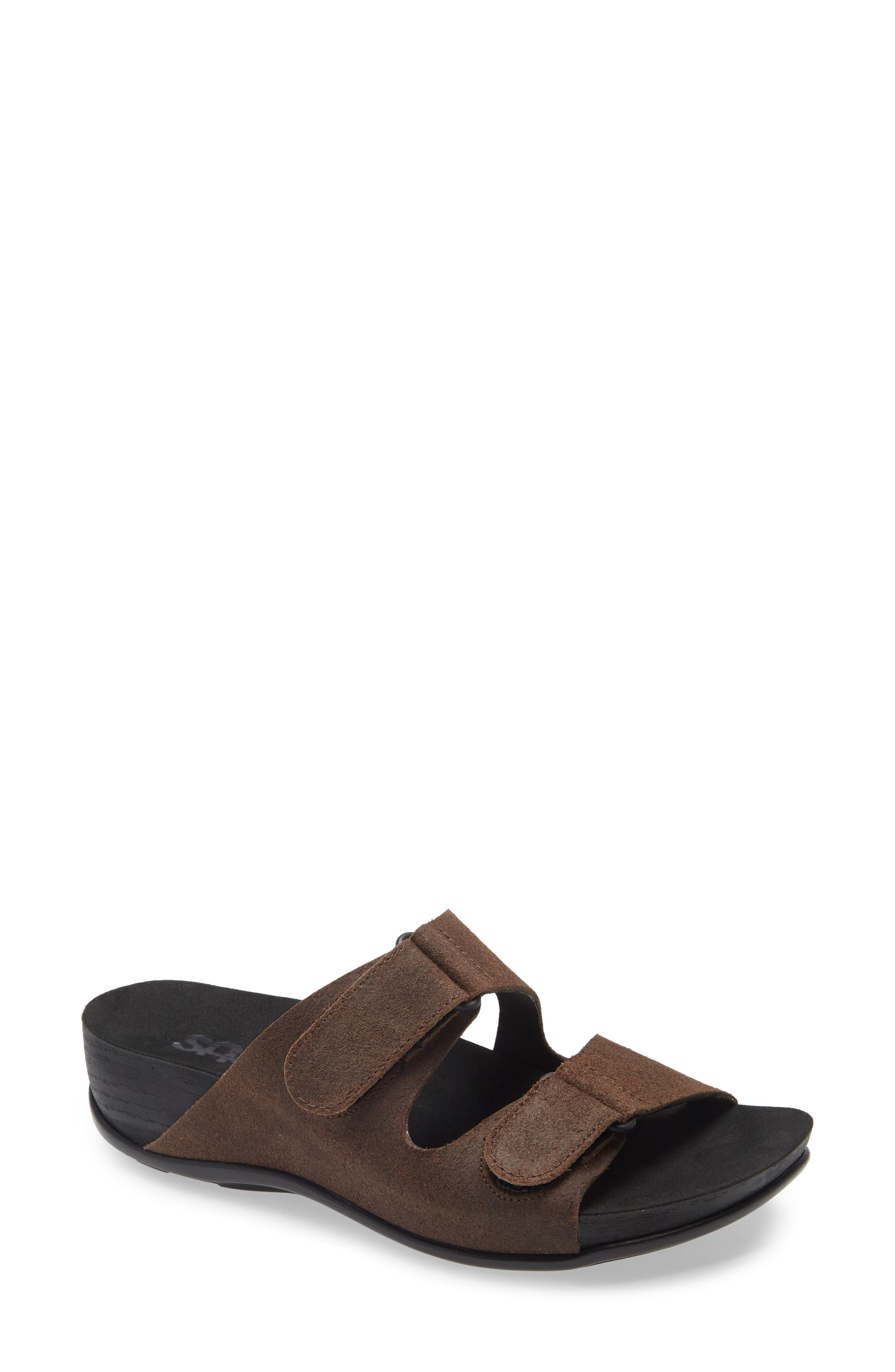 A contoured, cushioned footbed with arch support provides all-day comfort for a casual-chic slide topped with adjustable hook-and-loop straps for a custom fit. Style Name: Sas Seaside Slide Sandal (Women). Style Number: 6163180. Available in stores.