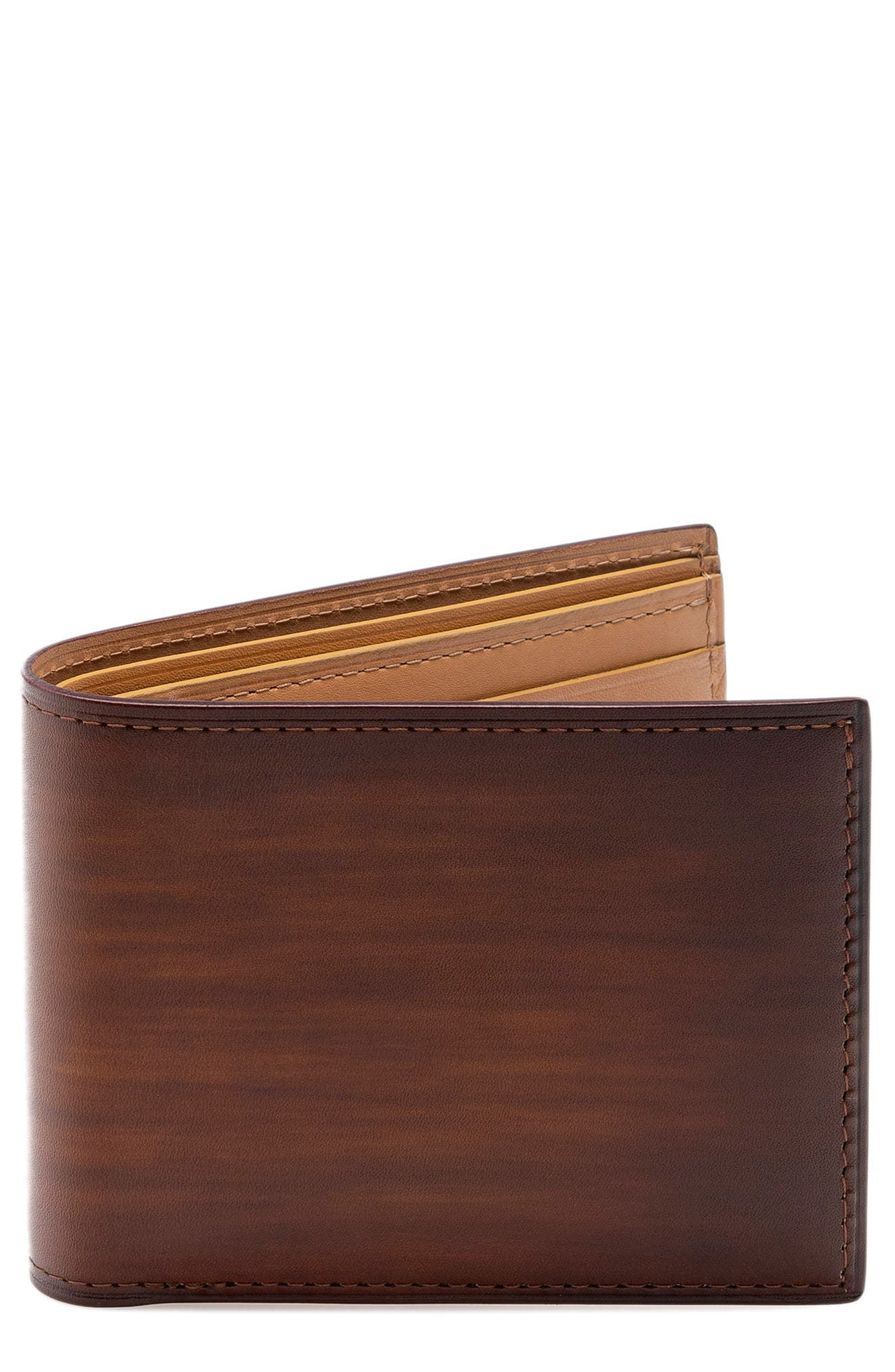 Hearty, hand-antiqued calfskin defines a handsome wallet with versatile style and utility. Style Name: Magnanni Leather Wallet. Style Number: 5851728. Available in stores.