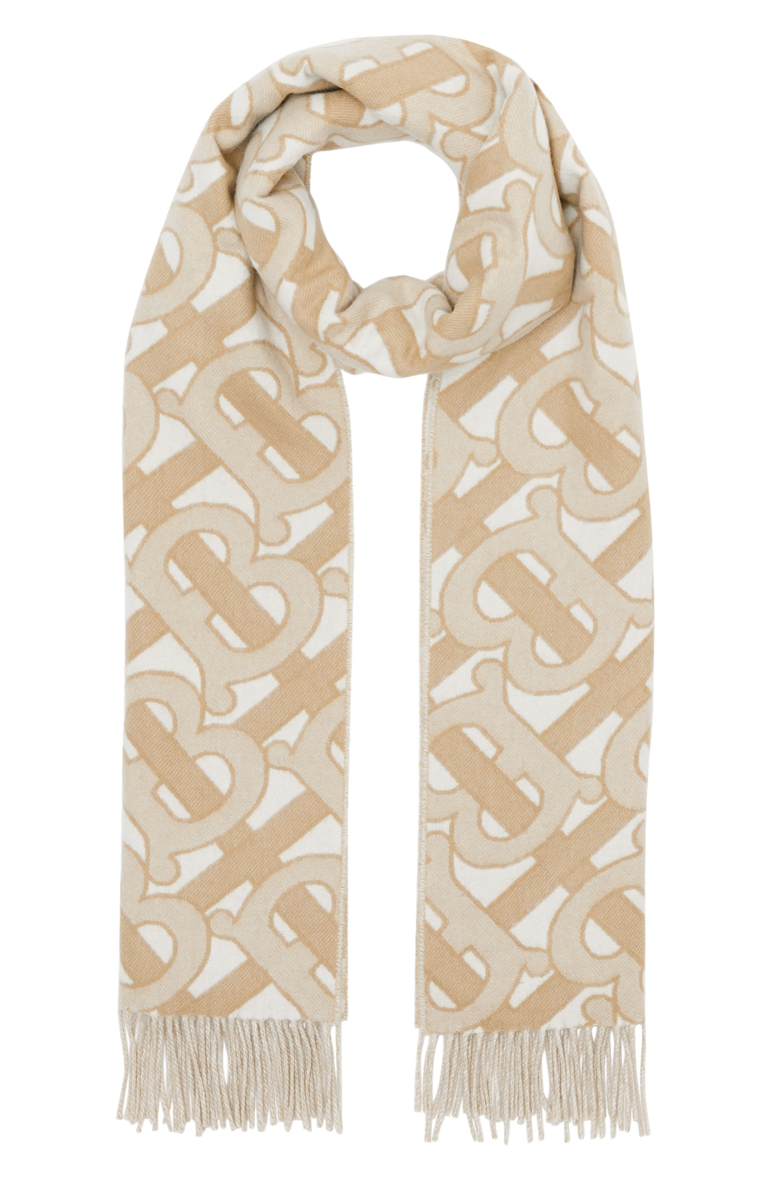 Delicate fringe tips a sumptuously soft cashmere scarf jacquard-woven in Burberry\\\'s signature and sophisticated Monogram pattern. Style Name: Burberry Monogram Jacquard Cashmere Scarf. Style Number: 5902908. Available in stores.