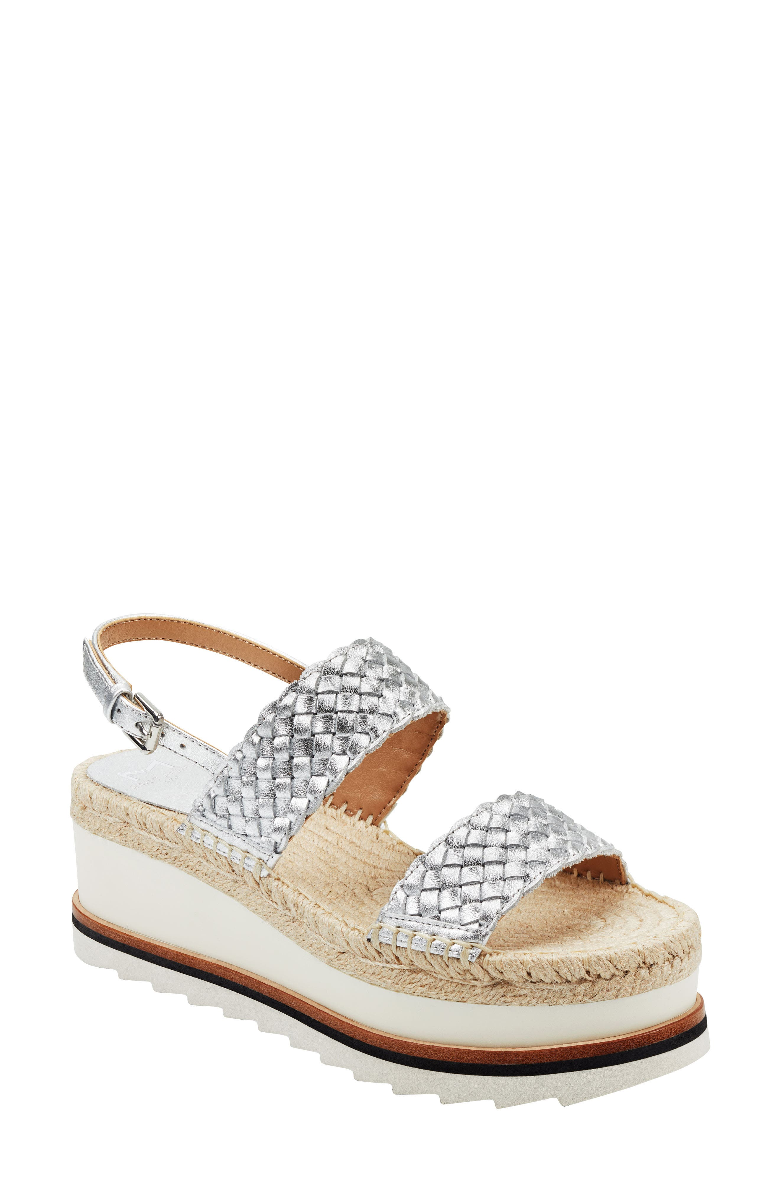 Woven straps cross the top of a breezy slingback sandal lofted by a chunky wedge and platform with an espadrille-style footbed. Style Name: Marc Fisher Ltd. Gabli Slingback Sandal (Women). Style Number: 6003555. Available in stores.