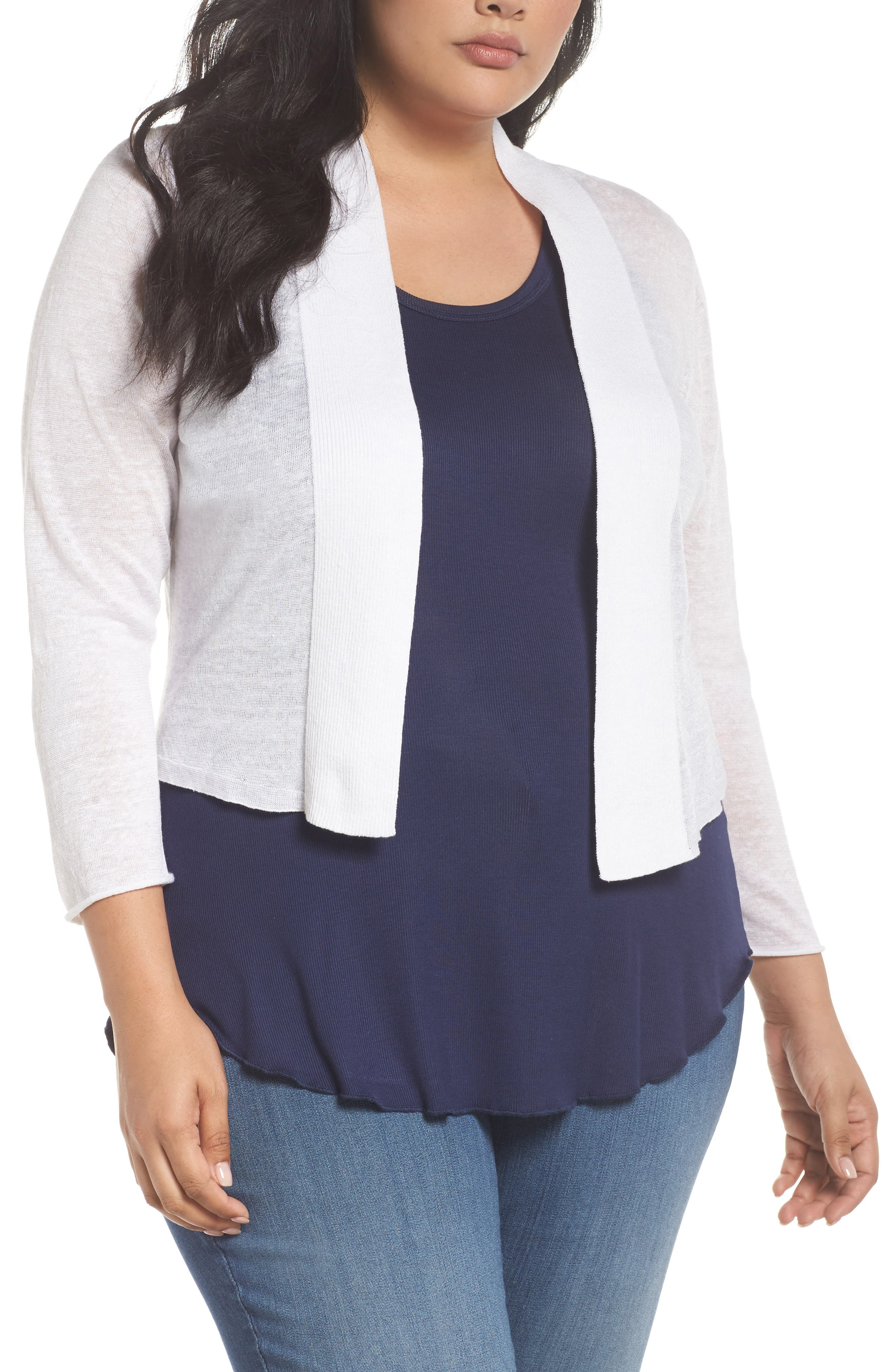 A cropped, open cardigan features a delicately slubbed, linen-blend knit contrasted with finely ribbed panels. The perfect layer when you want something airy-light and feminine. Style Name: Nic+Zoe Daybreak Crop Linen Blend Cardigan (Plus Size). Style Number: 5572936 1. Available in stores.
