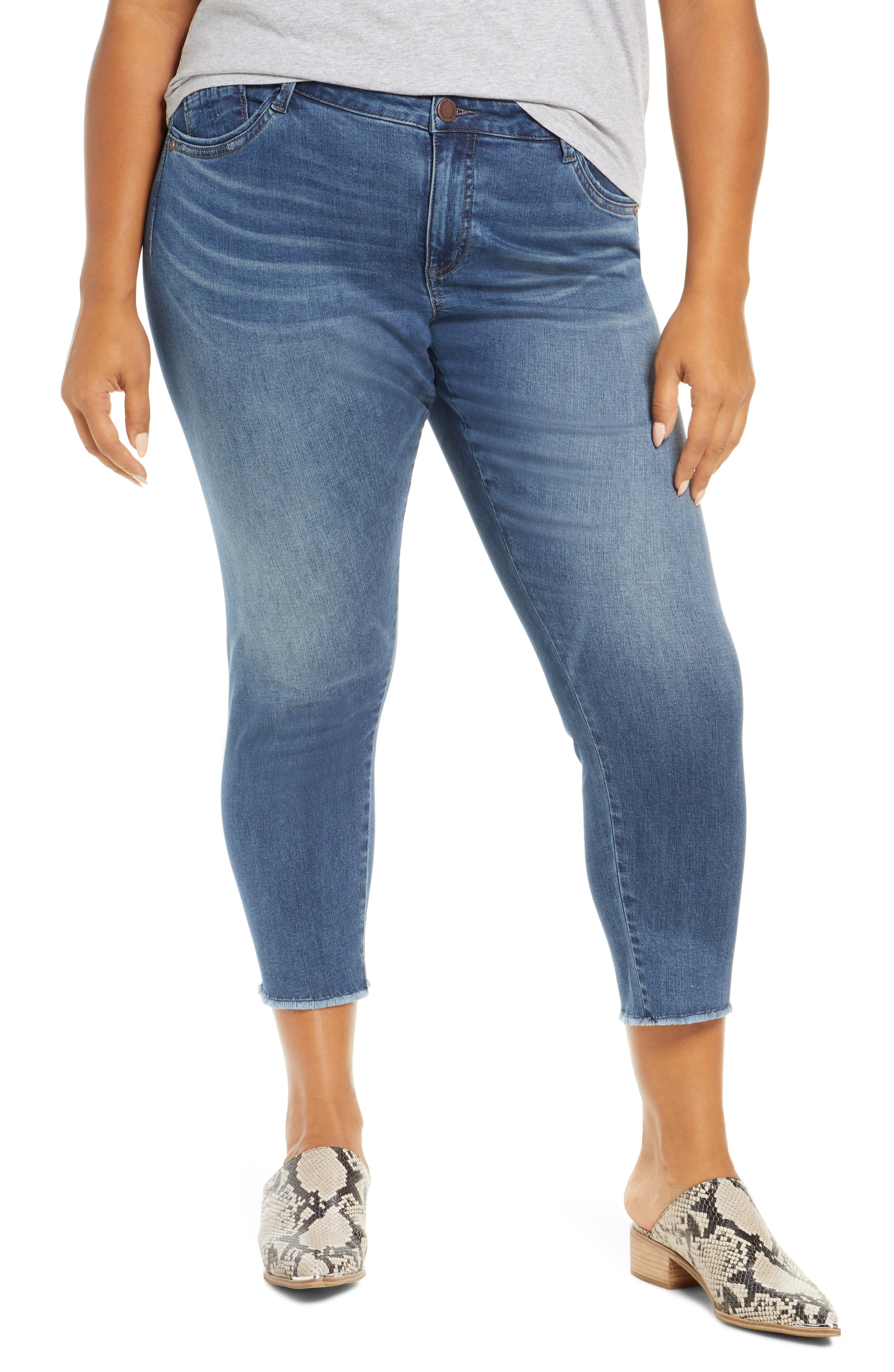 Seamless sides create a smooth, comfortable fit while frayed hems and a worn-in wash put these stretch-denim jeans right on trend. Style Name: Wit & Wisdom Seamless High Waist Raw Ankle Skimmer Jeans (Plus Size) (Nordstrom Exclusive). Style Number: 5972713. Available in stores.