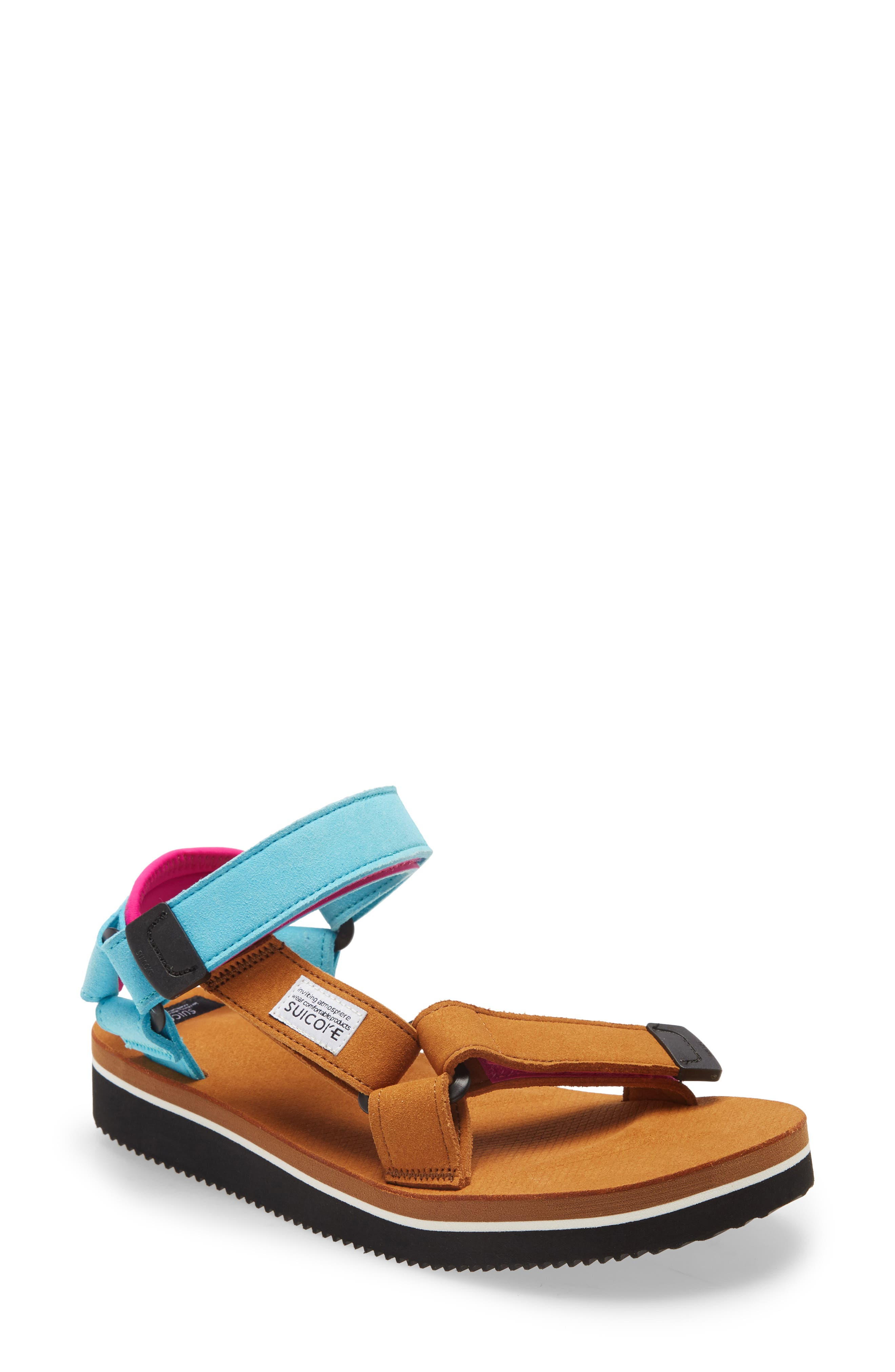 Comfortable enough for the outdoors and cool enough for the streets, this color-blocked sandal sports adjustable faux-suede straps and a cushioned heel pad. The molded, anatomical footbed provides optimal support and features antibacterial properties to keep feet feeling fresh. Style Name: Suicoke Depa-Ecs Sandal (Unisex). Style Number: 6070137. Available in stores.
