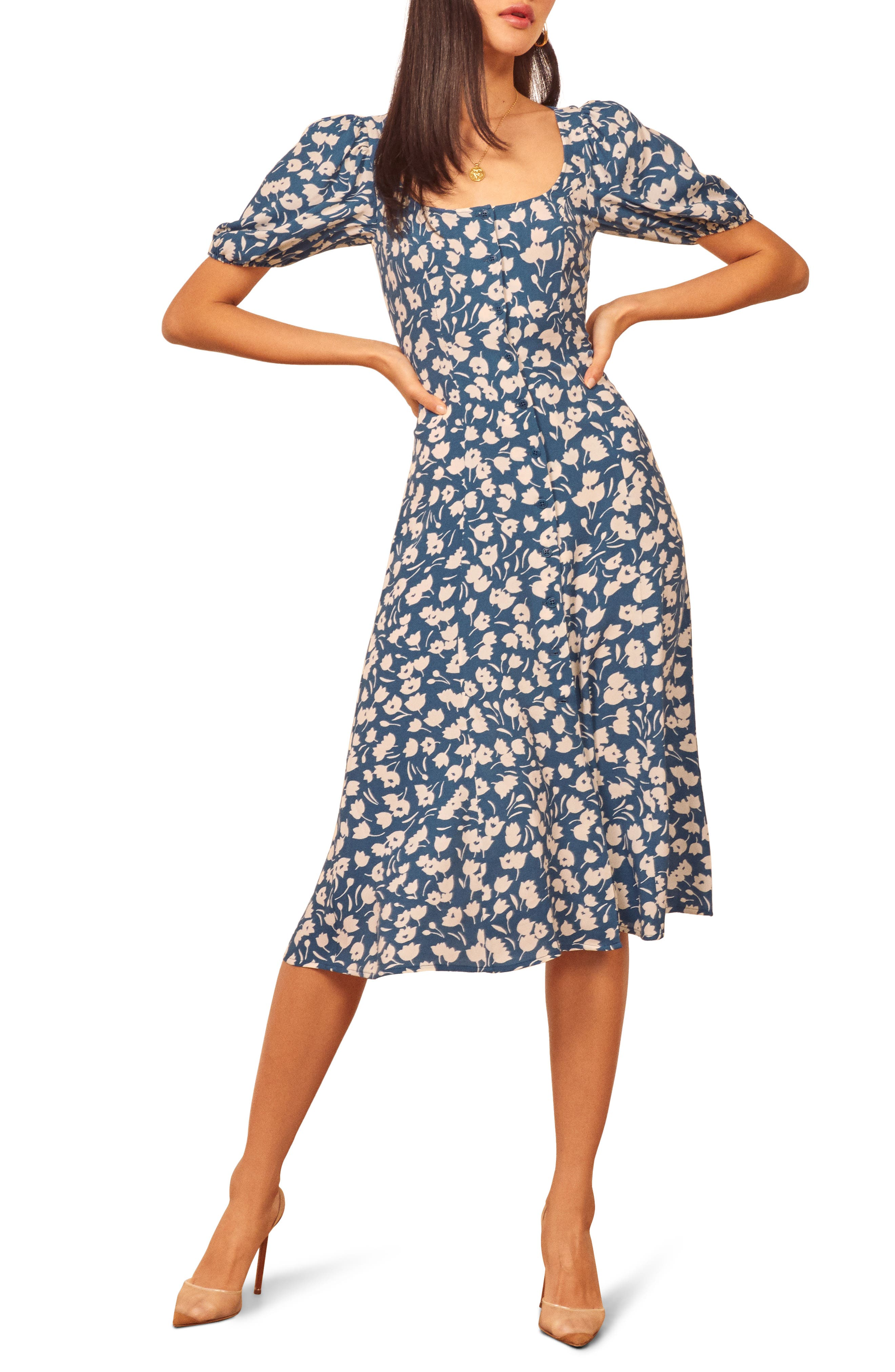 Fanciful allover blooms bring charm to this front-button midi framed with pretty puffed shoulders. Style Name: Reformation Beechwood Midi Dress. Style Number: 6036477. Available in stores.