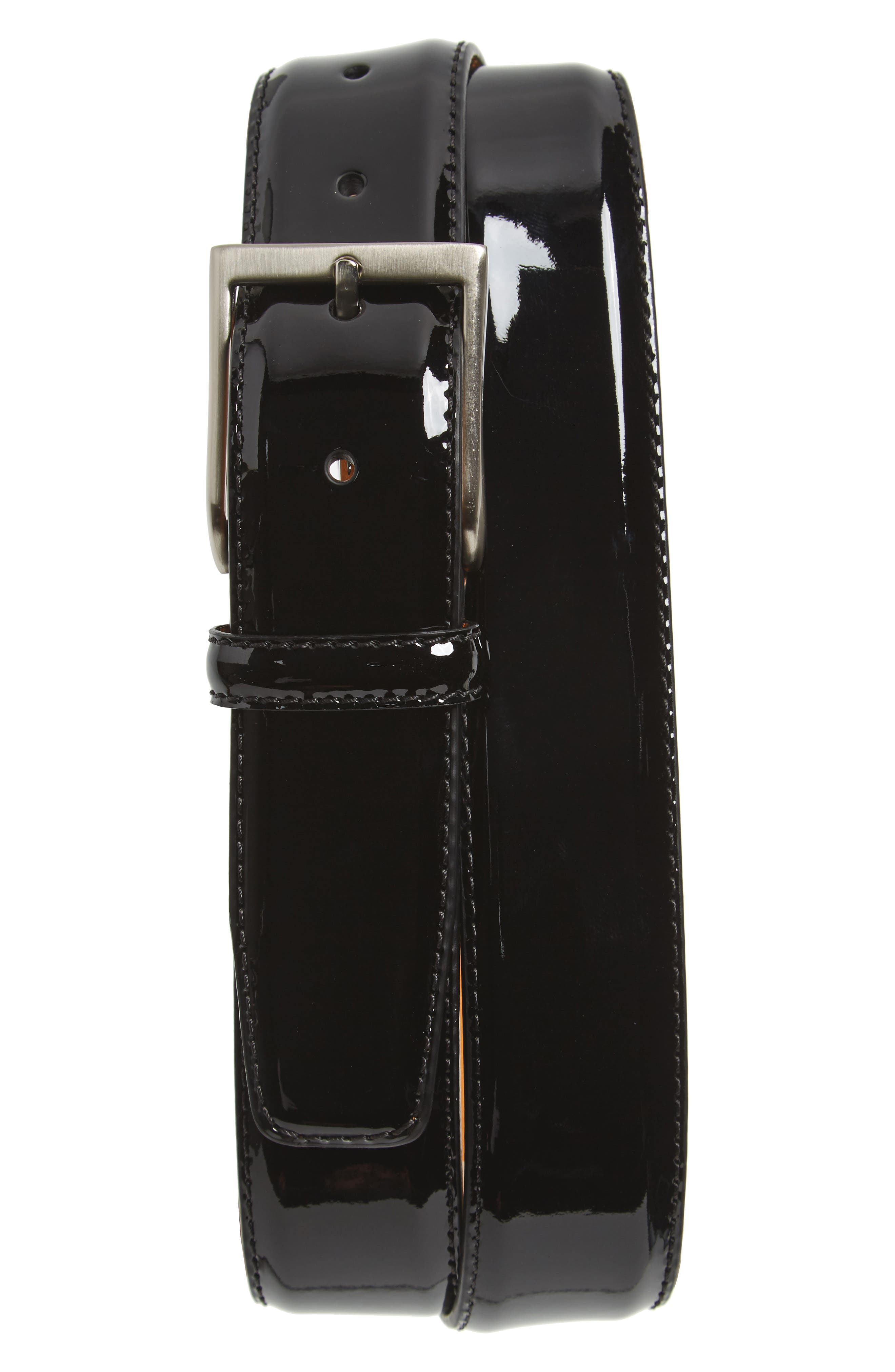 Glossy patent calfskin leather elevates a versatile, Spanish-made belt secured with handsome brushed-metal hardware. Style Name: Magnanni Patent Leather Belt. Style Number: 5368192. Available in stores.