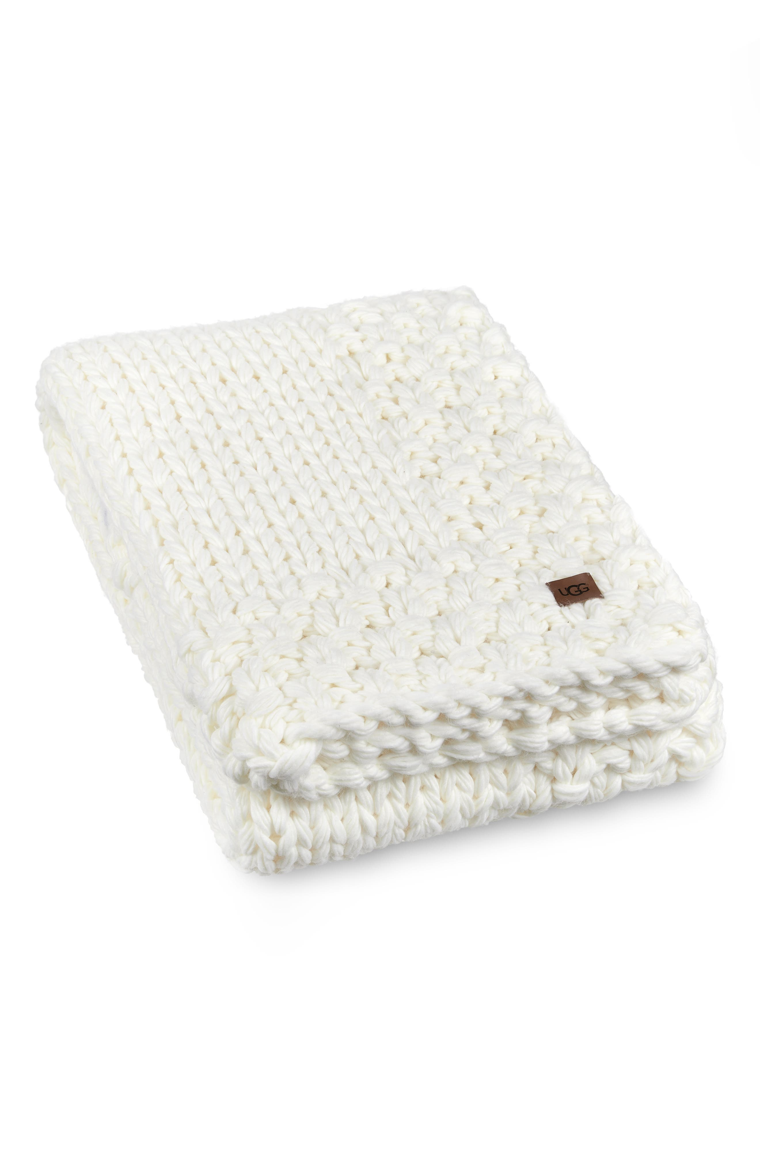 Sweater knit in soft, thick yarns, this throw blanket makes a marvelously cozy addition to any couch, chair or bedroom set. Style Name: UGG Averil Throw Blanket. Style Number: 5941633. Available in stores.
