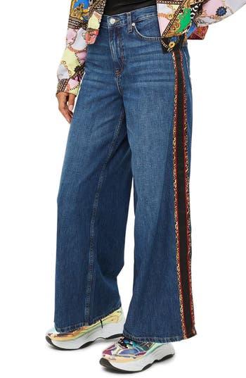 60s – 70s Pants, Jeans, Hippie, Bell Bottoms, Jumpsuits Womens Topshop Side Print Wide Leg Jeans $47.49 AT vintagedancer.com